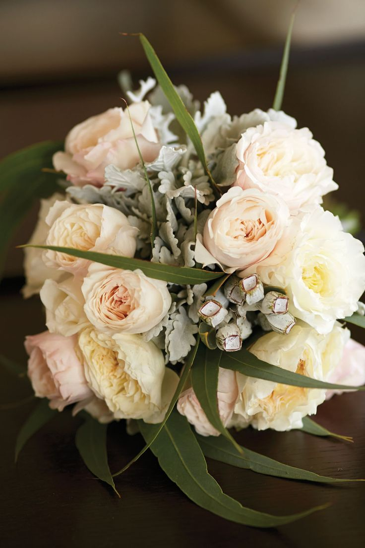 White and pink David Austin roses as well fresh eucalyptus and silver suede #bouquet. Click the link to see the florist.