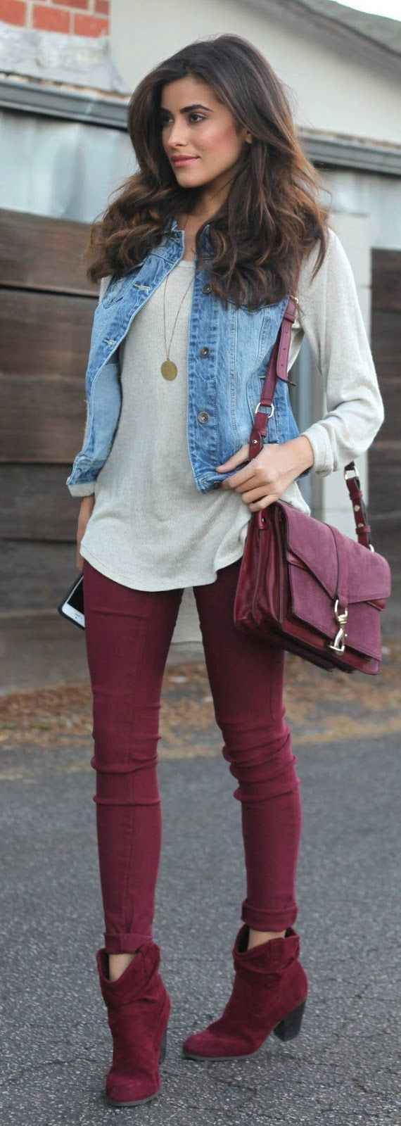 Shop this look on Lookastic: https://lookastic.com/women/looks/vest-oversized-sweater-skinny-jeans/14404   — Grey Oversized Sweater  — Gold Pendant  — Blue Denim Vest  — Burgundy Leather Crossbody Bag  — Burgundy Skinny Jeans  — Burgundy Suede Ankle Boots