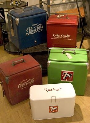 Vintage drinks coolers, including one that is lime green!