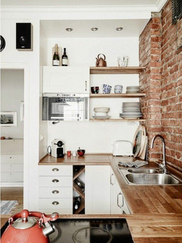 kitchen set up open wall shelves work surface brick wall
