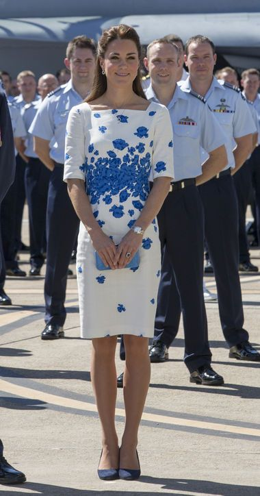 April 19, 2014 - On a visit to Brisbane, the Duchess of Cambridge debuted a blue poppy-print dress by L.K. Bennett, navy suede pumps, and a matching blue minaudiere.