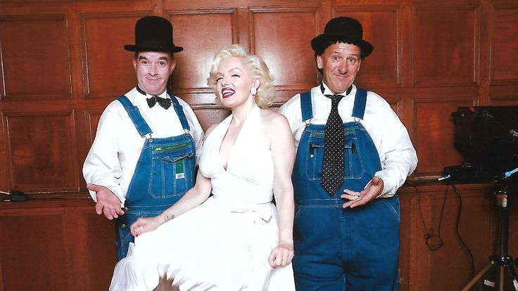 Laurel and Hardy Lookalikes posing for a photo with Marilyn Monroe lookalike and tribute artist Suzie Kennedy at the Summer Ball at The Wardroom, HMS Nelson, Portsmouth. Booked by Mike Sullivan Entertainments.