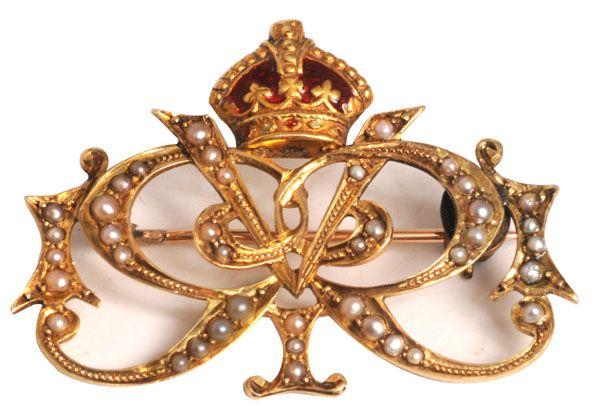 A Queen Victoria royal presentation gold, seed-pearl and enamel brooch, with crowned interlaced VR ('Victoria Regina') monogram. (Reeman Dansie)