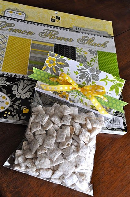 Cute way to wrap homemade treats :)  Just fill zip lock bag, staple on scrapbook paper, and add a bow!