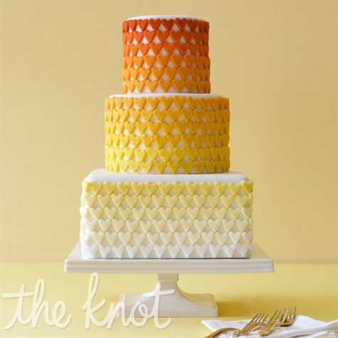 You usually think of ombre as high-style, but when it's done with sugar hearts, the result is more playful. Cake by Erica O'Brien Cake Design