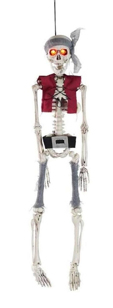 Delightfully scary, this spooky Pirate Skeleton with Lighted Eyes is dressed in a bandanna, red vest and black belt. His eyes light up to increase his frightful appearance. The quintessential Halloween decoration! Takes (3) 1.5 Volt Button Cell Batteries (not included).