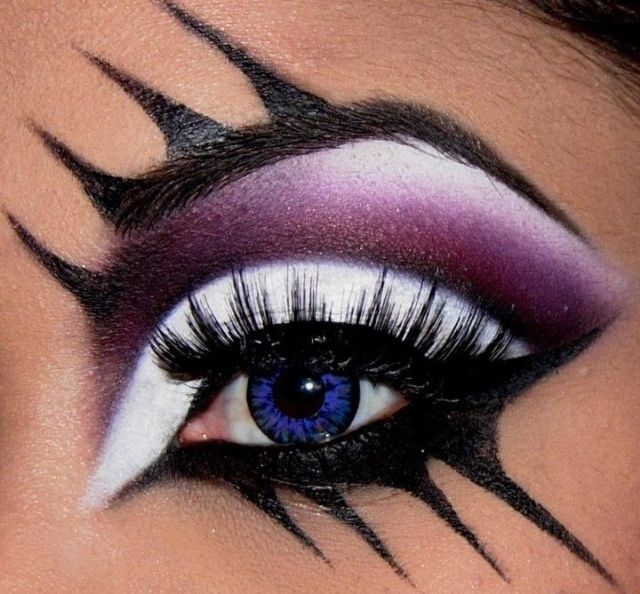 Bold purple/white/black eyeshadow. Could do this with makeup or with face paint