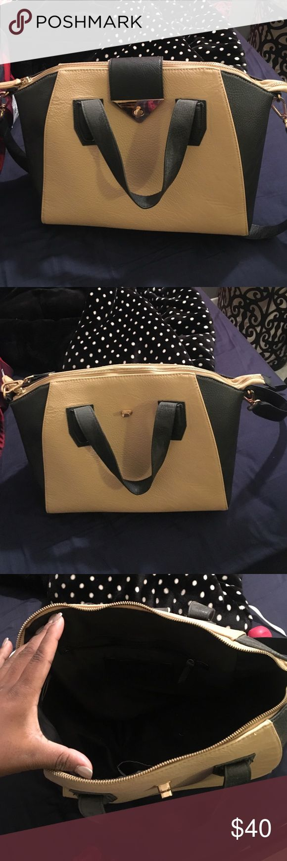 Purse Huge beige and black TopShop tote style purse. Can fit endless amounts of items inside. Has a zip pocket and phone compartment inside, with black lining. Very clean and looks brand new, except for a few minor scratches on the front claspe Topshop Bags Totes