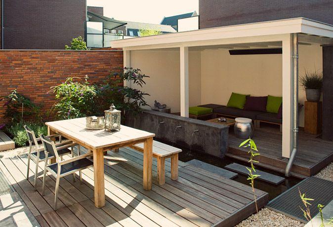 www.buytengewoon.nl. tuinontwerp - tuinaanleg - tuinonderhoud. Sfeervolle patiotuin in Woerden, met veranda, waterpartij, vlonderterrassen en verrassende details. www.buytengewoon.nl