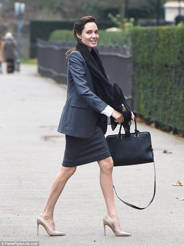 Walk this way: The Salt actress was dressed in smart business attire for the meeting...