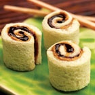 Peanut Butter and Jelly Sushi Rolls =   2 tablespoons JIF® Creamy Peanut Butter; 2 tablespoons SMUCKER'S® Strawberry Jelly, Jam, or Preserves (pick your favorite); 2 slices bread... Directions  1. Remove crusts from bread. With a rolling pin or large soup can, completely flatten bread. = 2. Spread 1 tablespoon of Jif peanut butter and 1 tablespoon of Smucker's fruit spread on each slice of bread. = 3. Roll each slice into a tight spiral. Cut each spiral into 4 pieces.