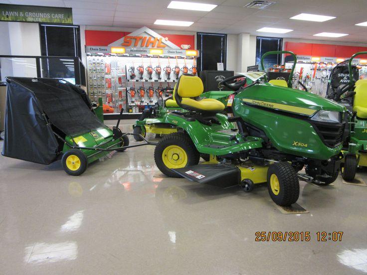 All wheel steer John Deere X304 pulling lawn sweepr