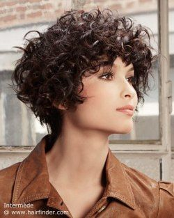 Short hairstyle for curly hair. Dark brown hair color.