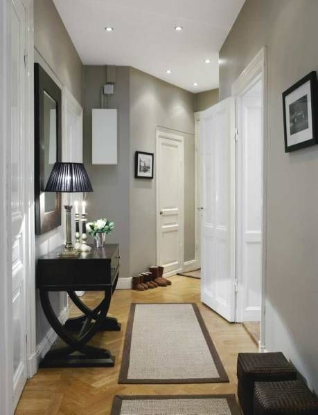 grey walls, white doors and trim, light wood floor, black furniture and accents
