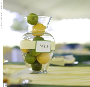 The couple mixed up their centerpieces: Their florist decorated some of the tables with vases filled with whole lemons and limes to carry out the wedding theme. Melany put together the vase labels beforehand using ribbon and card stock.