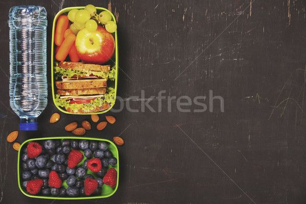 Sandwich, apple, grape, carrot, berry in plastic lunch box and b stock photo (c) klenova (#8309361) | Stockfresh