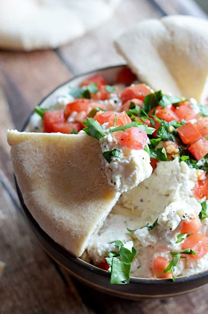 Garlicky Feta Dip.  This creamy, tangy dip goes great with pita and is easy to whip together as a party appetizer! | blog.hostthetoast.com
