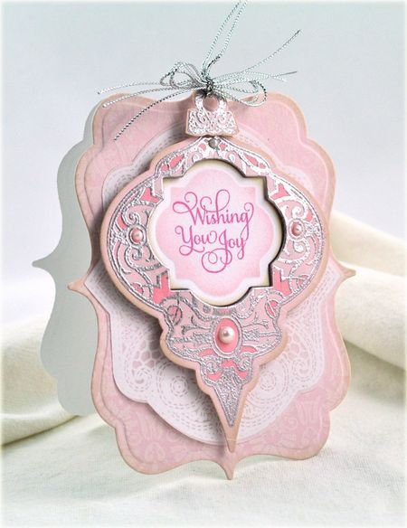 handmade Christmas card ... PINK!! and gorgeous too ... layered die cuts shape the card ... looks like the ornamant can be removed and placed on the tree ... fun idea ...