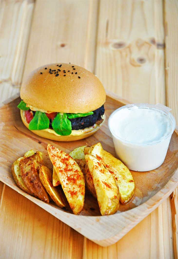 """Theseblack bean burgers served with crispy potato wedges and a delicious lemon-tahini sauce will surely become your favorite, homemade """"fast-food"""" meal!"""