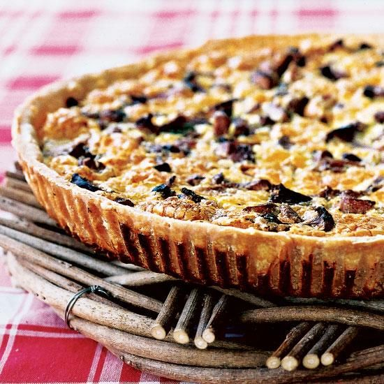 Mushroom and Ham Quiche | A bright, fruity wine, such as a light Beaujolais, is a lively contrast to the nuttiness of the Gruyère in this quiche.