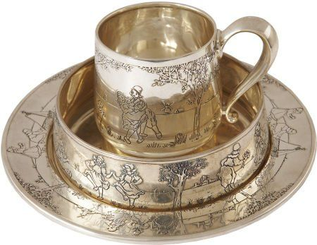 """Mary Pickford and Douglas Fairbanks Engraved Silver Tea Set. An ornate sterling silver tea cup, plate, and saucer set with each piece engraved """"Colleen Dionysia Skouras from Mary Pickford and Douglas Fairbanks/January 1926"""""""