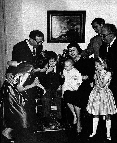 Georges Simenon: Baptism at Echandens, in 1959. l to r, 1st row: Mme Denise Simenon, Jean, the baby Pierre-Nicolas-Chrétian on the lap of Mme Achard. In the rear, Simenon and his eldest son Marc, of his first wife Regina Renchon. [and Marie-Jo and M Archard(?)]