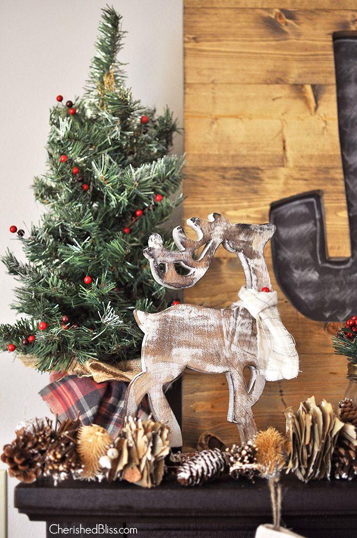Welcome in Christmas with this beautiful Rustic Woodland Christmas Mantel. Love that reindeer from @HobbyLobby !!