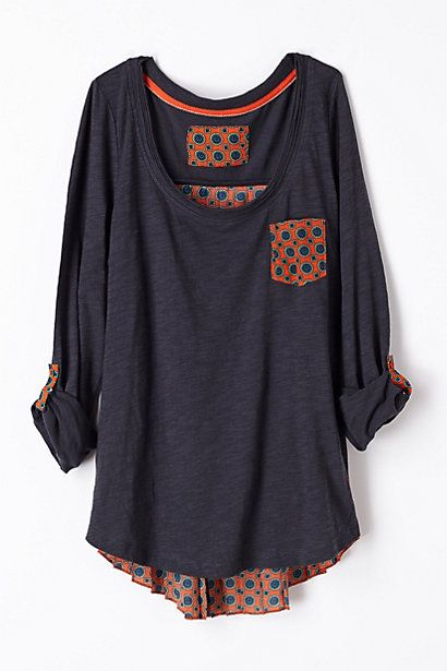 Perfect casual top to throw on with jeans and still be fashionable. Even looks long enough for my long torso.