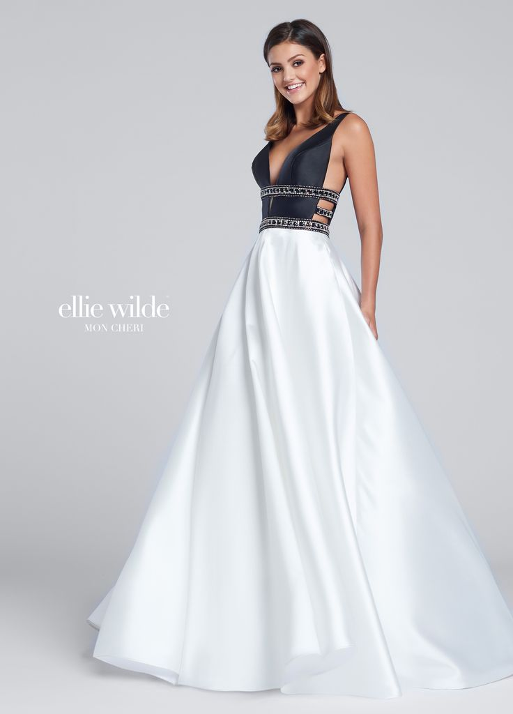 Ellie Wilde EW117144 - Sleeveless Mikado full A-line gown with plunging V-neckline, hand-beaded bands, contrasting full skirt with pockets.  Sister dress to styles EW117029 and EW117069.