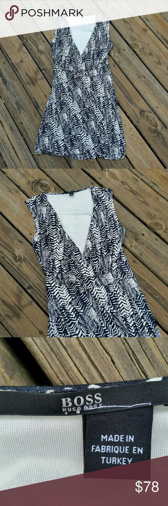 """HUGO by HUGO BOSS FAUX WRAP DRESS Black and cream printed, faux wrap dress by Hugo Boss. 100% viscose.  Fully lined. Excellent condition! Like new! 34"""" waist. 40"""" chest. 40"""" length. HUGO Dresses"""