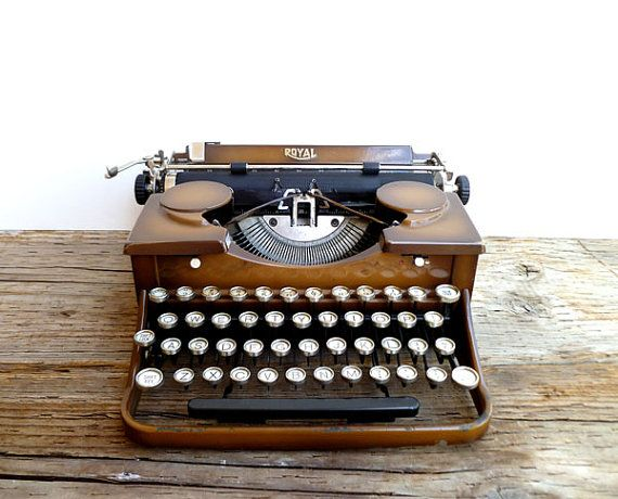 Gorgeous old 1030's typewriter on Etsy. <3  Ours was all black, and a bit more battered from lots of use but I remember my fingers slipping off the keys sometimes!