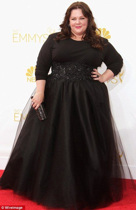 Melissa McCarthy sported a long dramatic black dress at the 2014 Emmys http://dailym.ai/1lufdYb