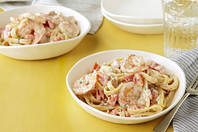 """Looking for a """"devilishly"""" delicious pasta recipe? Look no further.  Try this fettuccine and shrimp tossed in a garlicky tomato-cream sauce."""
