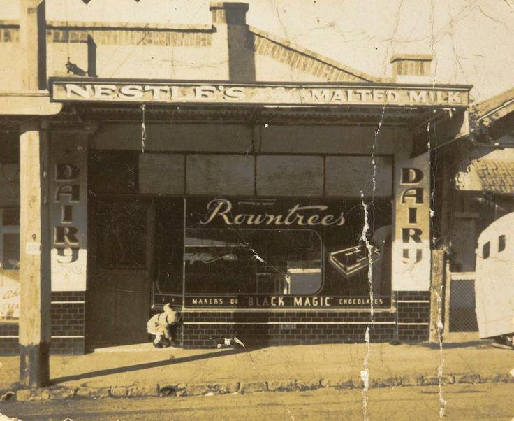 Digital Photograph - Infant Playing outside Milk Bar Shop, Moonee Ponds, 1949 - Museum Victoria