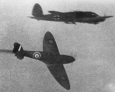 Actual combat footage. A Spitfire banking through a formation of Heinkel He-IIIs.