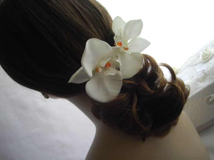This item was featured at the Martha Stewart Wedding Party produced by The Wedding Library at Gotham Hall in New York City.  Once again available and ready to ship. Hair alligator clip (above with teeth interior). Orange center.  I have tried to find the most realistic looking silk orchid for you to wear for a special occasion. Description: This is a large silk orchid measuring at its widest point 4 1/2 inches wide by 3 inches.  Designed for hair styled either up or down. One orchid that...