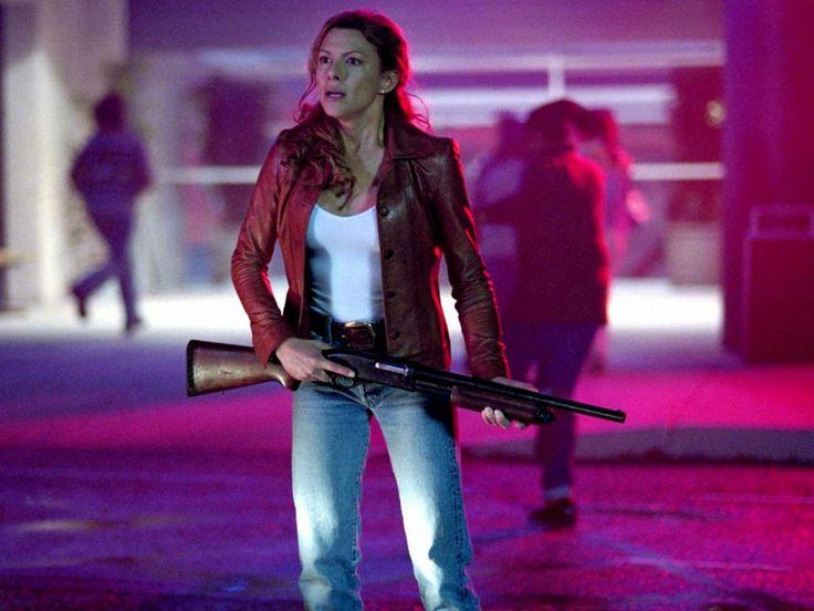 Celebrity with guns: Kari Wuhrer - Eight Legged Freaks