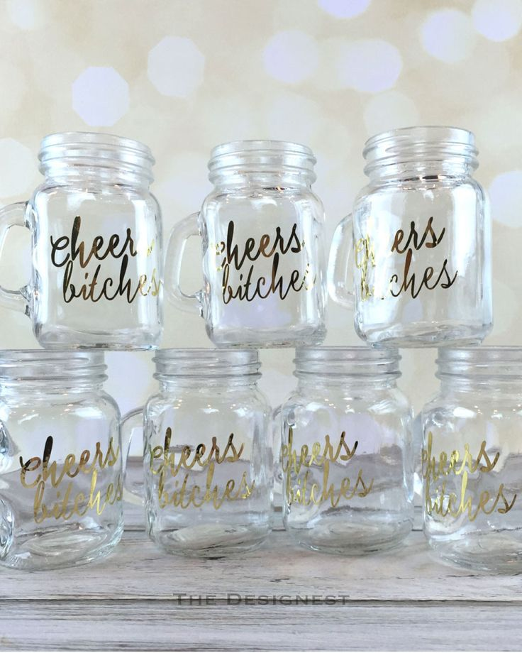 These mason jar shot glasses are on the top of the list when it comes to must haves! 'Cheers Bitches' in a hand scripted font. Done in chrome gold lettering. These are made of glass and measure approx