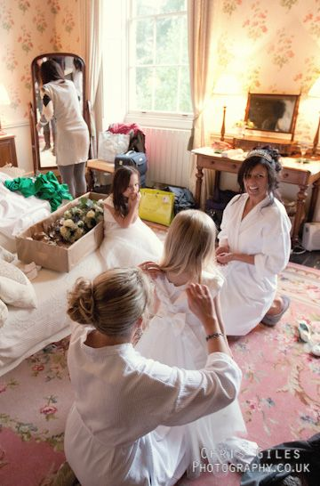 Bride and Bridesmaids getting ready got to have a photo like this