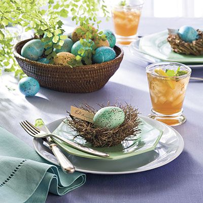 Robin's Egg Place Cards -    Decorate your spring table with a speckled surprise. A tiny nest makes an ideal place card holder when filled with an egg that's been dyed a soft shade of blue. For an authentic robin's egg look, use a toothbrush to add delicate markings with brown craft paint.