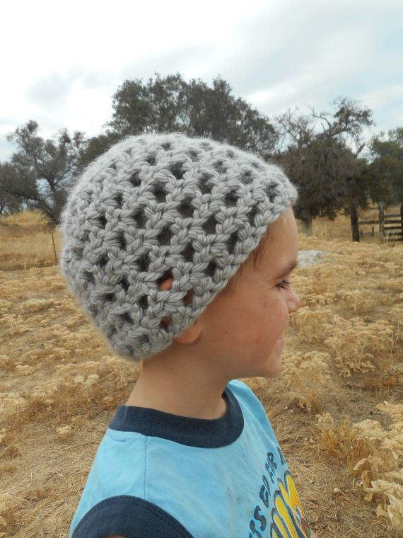 Made to fit a toddler, this cute gray hat will keep their head warm and covered on chilly days. Care Instructions: Machine wash max temperature 30°C or 86°F, do not bleach or iron, tumble dry normal, and dry clean any solvent.  Dimensions: -6 1/2 inches tall -9 inches wide -18 inches circumference -Fits the average 3-8 year olds head  There may be a difference in color due to a difference in monitors and lighting.  Thank you for visiting our shop! If you have any questions or requests, f...