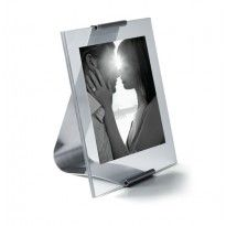 How about a modern take on the classic frame. Reflection Photoframe by Georg Jensen features a striking glass panel held by satin polished steel curved stand. Model ref: 3585542 RRP: £55 #georgjensen #orjewellers #giftware #photoframe #glass #steel