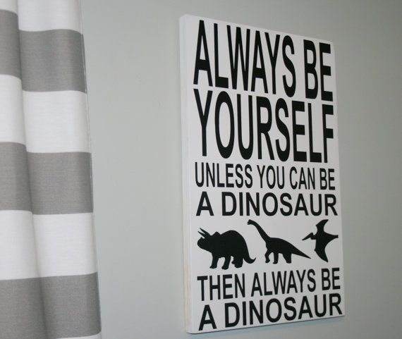 This Dinosaur sign measures 12 x 18 and is 3/4 thick. It is made of hardwood maple and has an alligator hook on back for hanging. Can also be propped up on a shelf. Looks great in a boys bedroom, baby nursery or playroom. It is hand painted with vinyl lettering. Can be made white with black writing as shown or black with white writing.