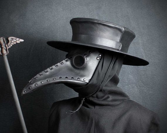 A Black Leather.bird mask.  Why is it scary?  It certainly looks creepy, and not without reason.  During the Black Plague, Italian doctors wore these to keep from inhaling airborne contaminants.  Bubonic plague had a sister virus called pneumonic plague, which was airborne, and therefore twice as deadly.  In those days they didn't know viruses worked, but they understood contagion!