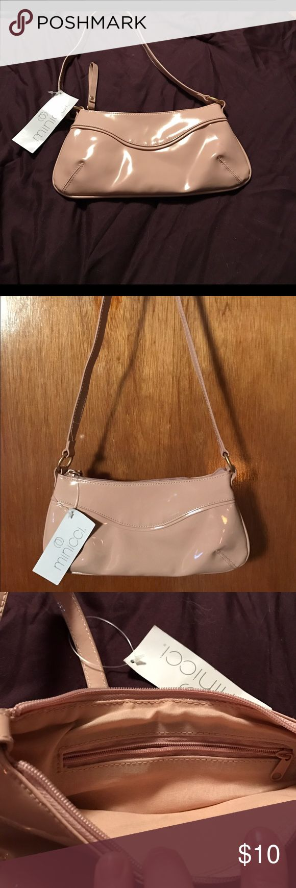 """Cute peachy/beige handbag Casual faux patent leather purse. So soft! Interior lining matches neutral purse color. Zippered pocket inside.  Dimensions 10""""W x 5""""H x 1/2""""W  strap is 34"""" long and is not adjustable. Zippered closure has matching faux patent leather pull. Excellent condition. No marks or scratches seen on inspection. Minicci Bags Mini Bags"""