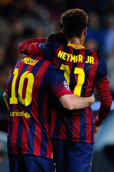 Lionel Messi of FC Barcelona celebrates with his team-mate Neymar of FC Barcelona after scoring the opening goal during the UEFA Champions League Group H match between FC Barcelona and AC Milan at Camp Nou on November 6, 2013 in Barcelona, Catalonia.