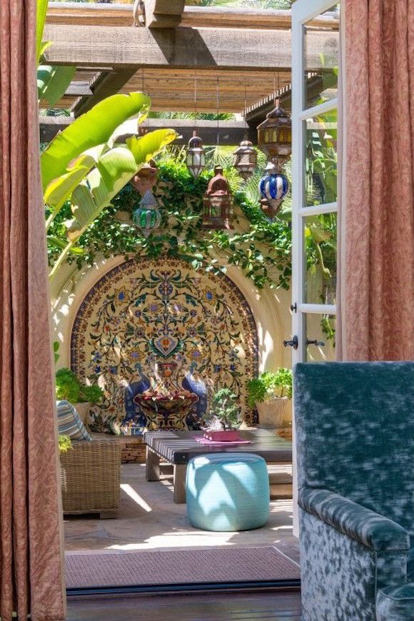 Doors to patio in Brentwood, California Spanish Revival home. For sale at nearly $12M USD.