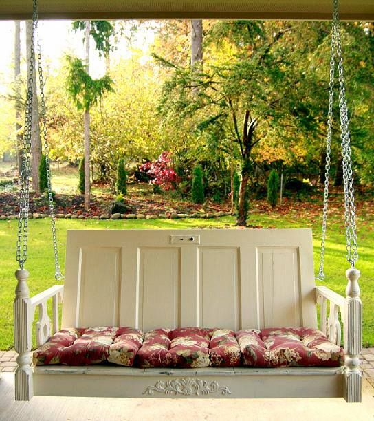 Shabby Chic Porch Swing made from an old door and decorative wood pieces purchased from home improvement store. So neat!