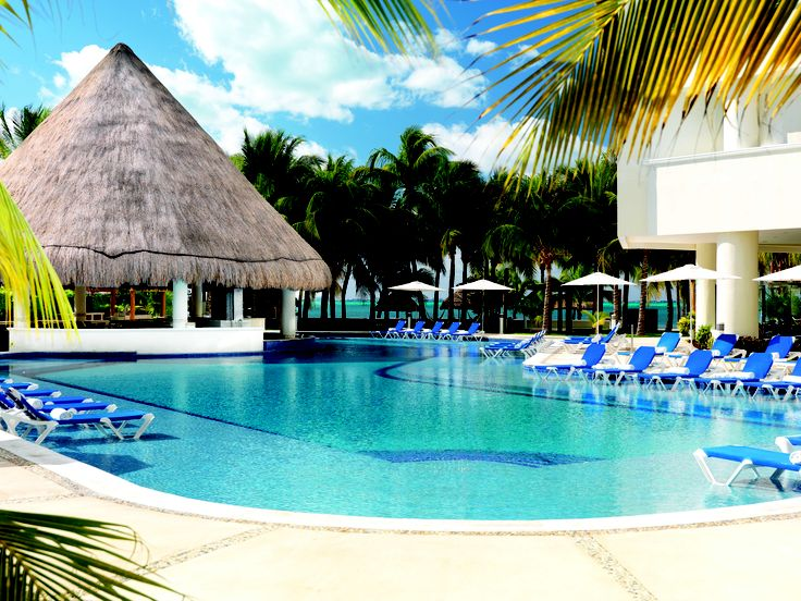 Stunning pool with swim up bar at Isla Mujeres Palace in Mexico