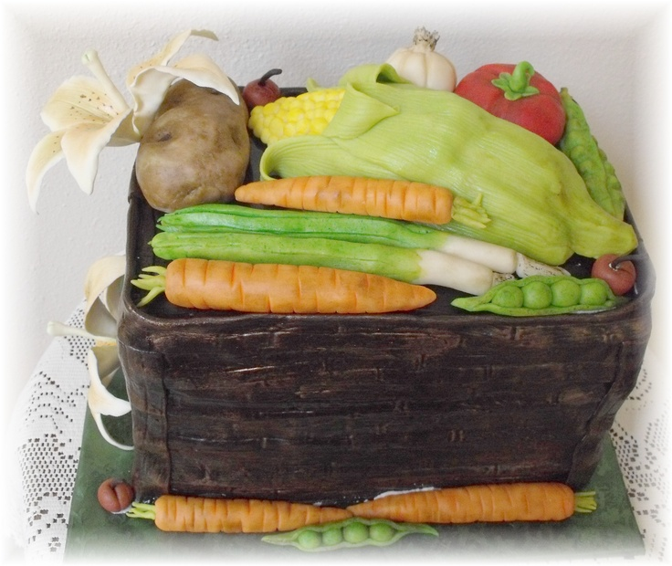 Basket of Vegetables cake.  Modeling chocolate and fondant vegetables on fondant cake.  Creative Cakes by Patty